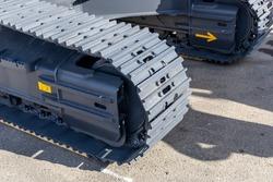 Crawler excavator track shoe. Close-up of tractor tracks. Chassis of the crawler excavator. New construction equipment