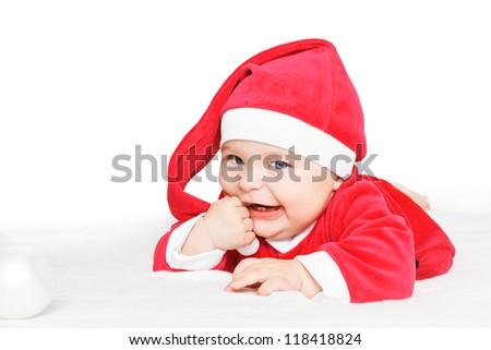 Crawling baby in Santa Claus costume
