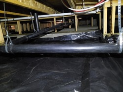 Crawlspace under a residential building with new vapor barrier.