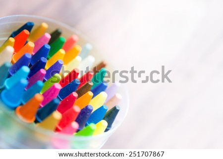 Crayon abstract. Vivid and strong colored crayons fading into bright white light.