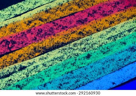 crayon drawn rainbow spectrum on black background