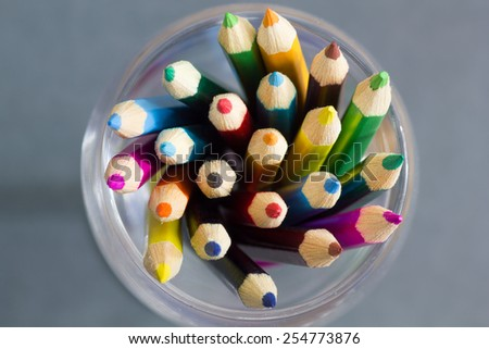 crayon in the glass In white background