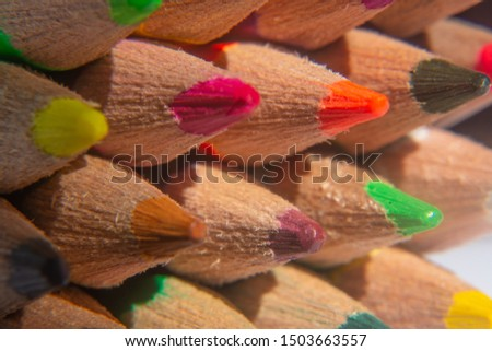 crayons all bunched together for an abstract image giving some blurred and some in focus