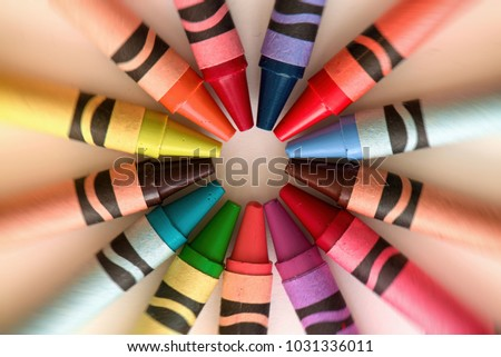 Crayons color pencils circular abstract background and art #1031336011