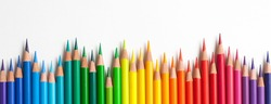 Crayons - colored pencil set loosely arranged  on white background. colored pencils are not arranged exactly in a row.