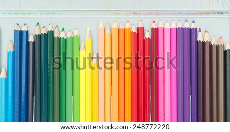 Crayons. Colored Pencils. colored pencils on white background and wood chips