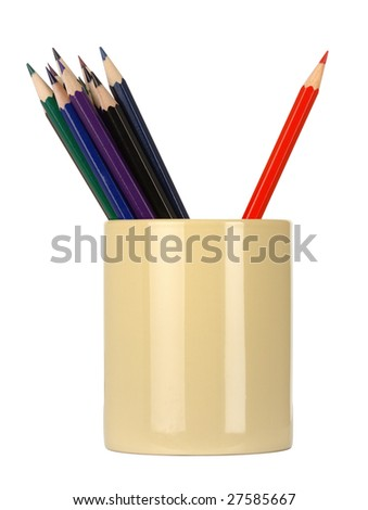 Crayons in a cup, red one is leaned agings the others, standing out of the crowd concept, isolated over white
