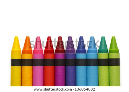 Crayons lined up in rainbow isolated on white background.