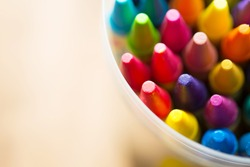 Crayons shot form above with. Shallow depth of field for dreamy impressional feel .