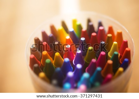 Crayons shot from above with incoming light. Extremely shallow depth of field for dreamy impressional feel .Soft focus filter used.