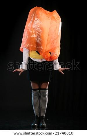 Crazy ashamed girl with plastic bag on her head.