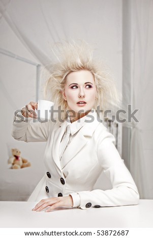 Crazy Business woman Woman sitting at the table drinking coffe in white outfit