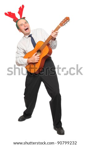Crazy businessman with guitar singing. Christmas and new year party concept.