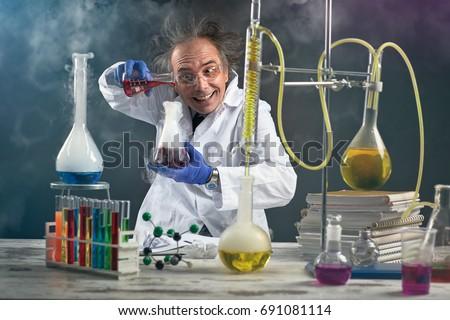 Crazy chemist doing experiment chemical laboratory