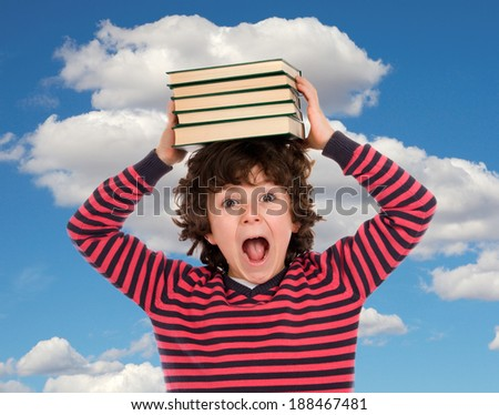 Crazy child shouting with books on the head