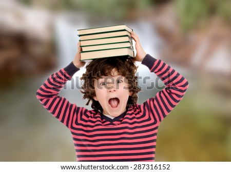 Crazy child with books on his head shouting