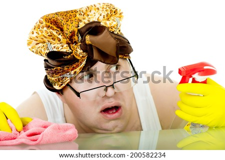 crazy cleaner with a scarf on her head, yellow rubber gloves on his hands and pink dust cloth shows his fear because he spent the entire bottle of detergent for cleaning glass/crazy cleaner