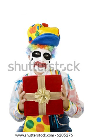 Crazy clown holding red velvet gift box isolated on white