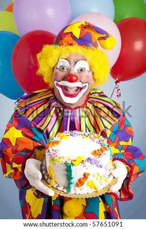Crazy Clown With Balloons, Holding A Birthday Cake. Stock Photo