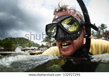 Crazy diver getting wet