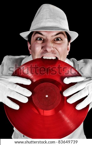 Crazy DJ Biting Record wearing white hat, suit and gloves
