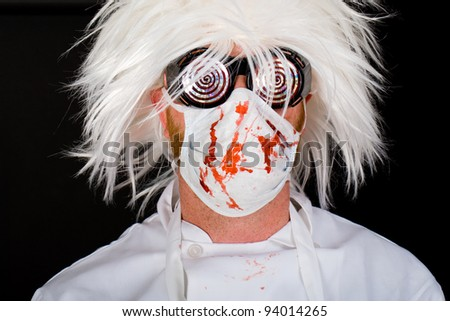 Crazy Doctor with a surgeon mask and scrubs splattered with blood.  Possibly a Halloween costume, maybe he's just nuts.