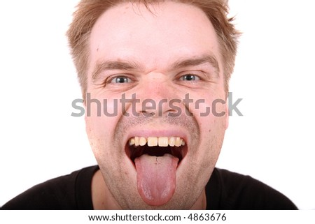 stock photo : Crazy face of ugly man lolling out his tongue