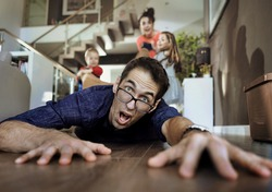Crazy family having fun at home