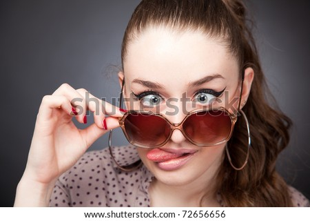 Crazy girl with glasses, portrait studio isolated shot