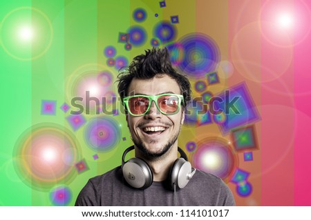 Crazy guy with headphones on colorful background