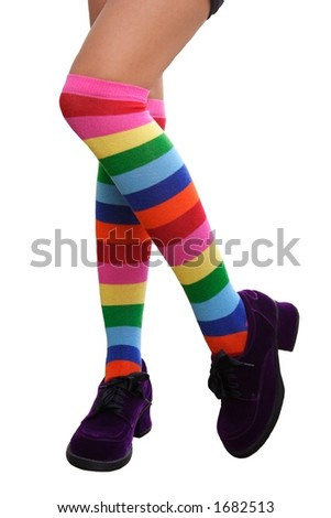 Crazy Legs.  Pretty legs in a crazy comination of multi-colored striped knee-his & chunky purple suede shoes.
