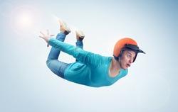 Crazy man in red helmet is flying in the sky. Jumper concept