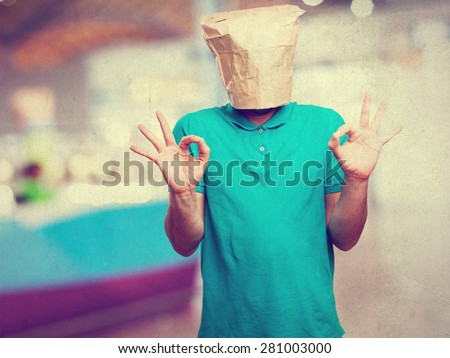 crazy man with paper bag in his head