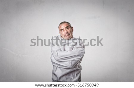 crazy man with straitjacket looking up Foto d'archivio ©