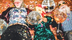 Crazy people celebrating at new year party inside nightclub - Fashion friends having fun together drinking champagne and wearing funny masks - Nightlife and fest concept - Focus on center disco ball