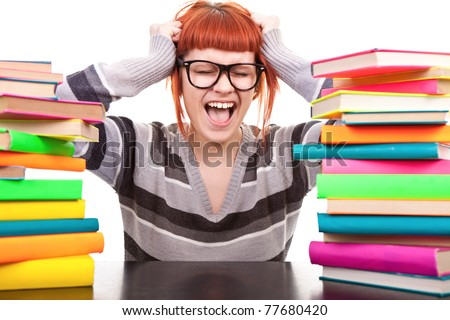 crazy schoolgirl screaming, holding hands up, between, stack of book, isolated on white