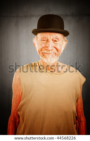 Crazy senior man in bowler hat on white background