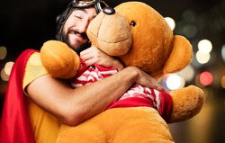 crazy super hero with teddy bear