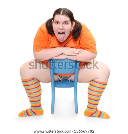 Crazy teenager on a blue chair. Behavioral disturbance in the pubescence.