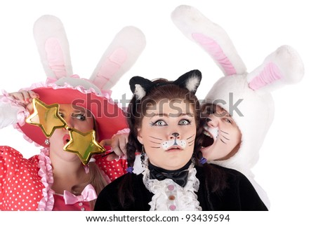 crazy trio of the young pretty actors in the costumes of the cat and the bunnies