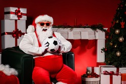 Crazy white grey hair santa claus hold soccer ball have christmas everegreen tree x-mas decoration isolated bright shine color background