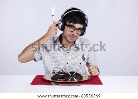 Crazy young man eating music at his dinner plate