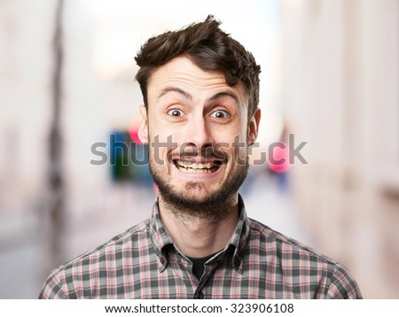 crazy young man happy pose - Shutterstock ID 323906108