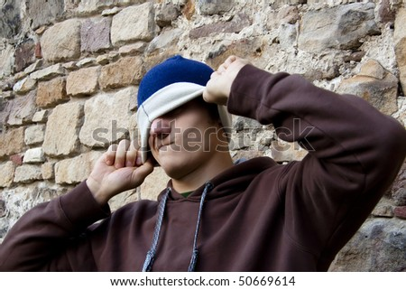 Crazy young man in blue and white cap.