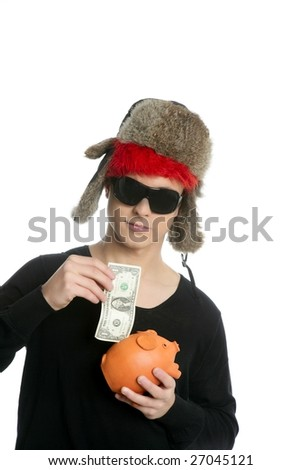 Crazy young student boy, one dollar in piggy bank with winter hat