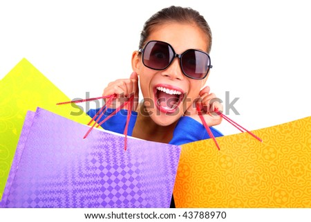 Crazy young woman on a shopping spree. Isolated on white background.