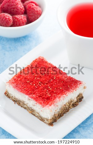 cream cakes with raspberry and fruit tea, top view, vertical