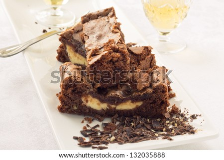 Cream cheese brownies on a white plate