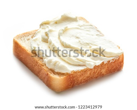Cream cheese on bread isolated on white background