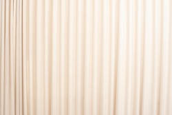 Cream-colored cloth, beige curtain fabric texture and background.